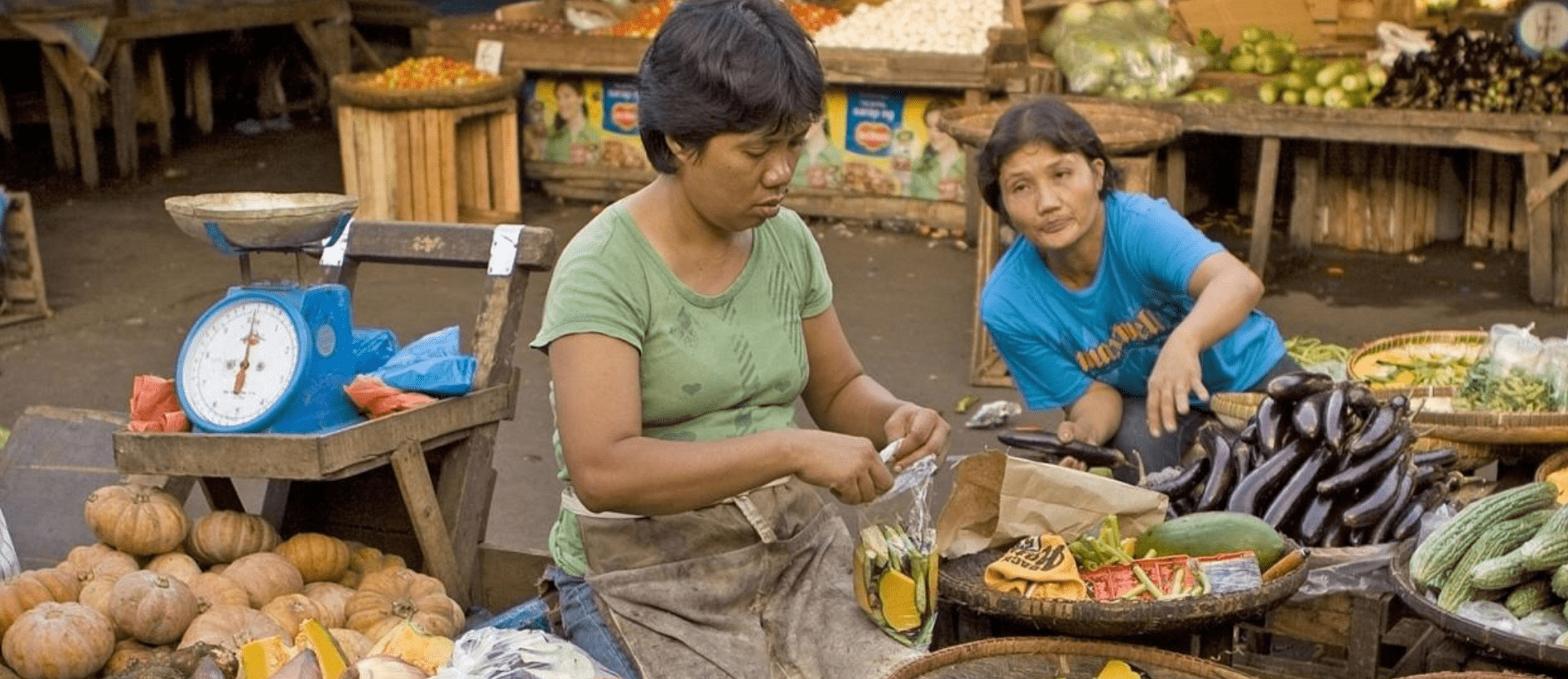 Two women in food market